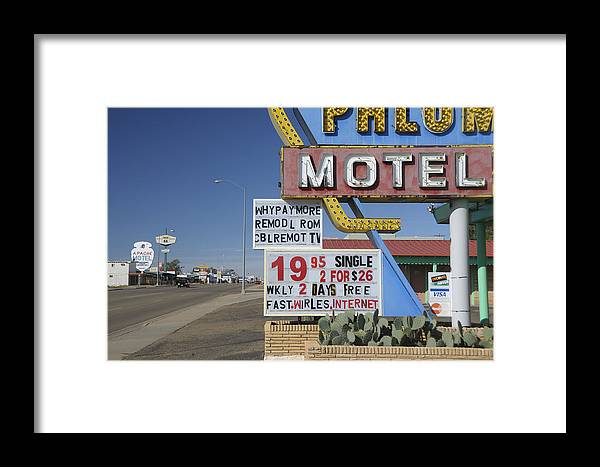 Motel Sign Framed Print featuring the photograph Tucumcari by Christian Heeb