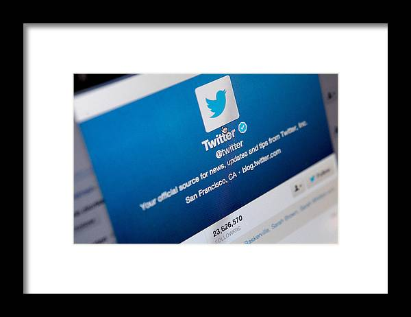 Corporate Business Framed Print featuring the photograph Twitter Announces Plan To Float On Stock Market by Mary Turner