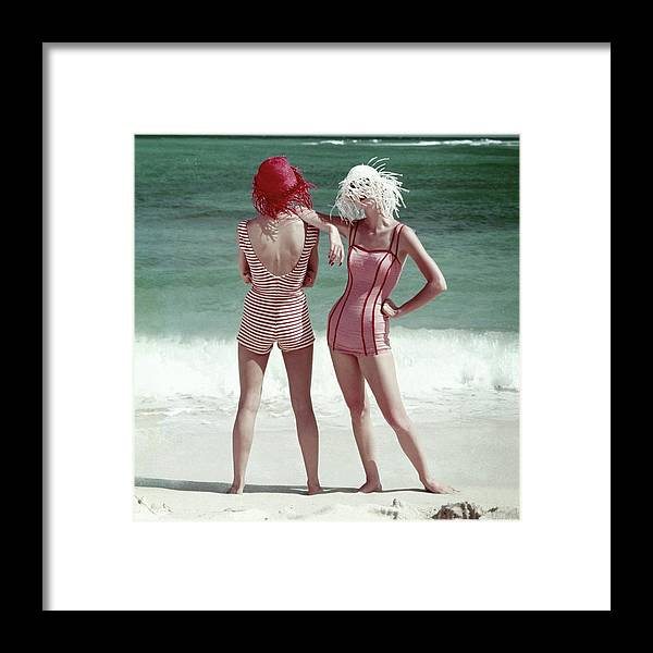 Two People Framed Print featuring the photograph Two Models Standing On A Beach by Frances McLaughlin-Gill