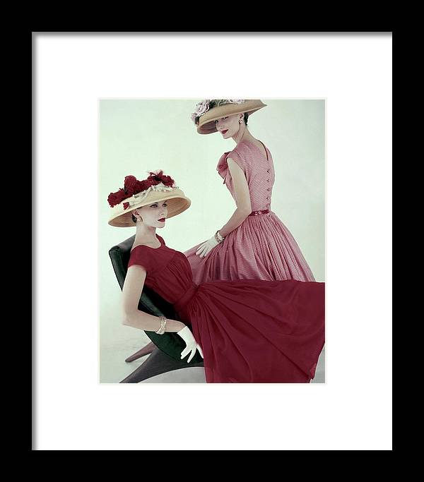 Fashion Framed Print featuring the photograph Two Models Wearing Red Dresses by Karen Radkai