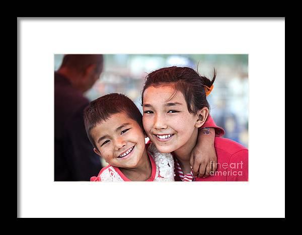 China Framed Print featuring the photograph Uighur Children At Kashgar Market Xinjiang China by Matteo Colombo