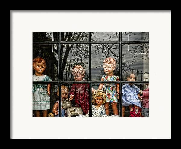 Dolls Framed Print featuring the photograph Uncertainty by Joanna Madloch