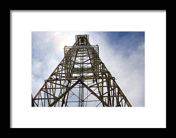 Oil Well Framed Print featuring the photograph Up The Down Hole by Robert Brown