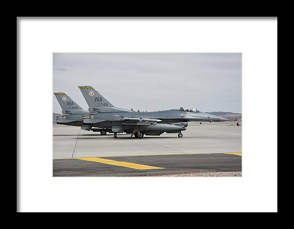 Nellis Air Force Base Framed Print featuring the photograph U.s. Air Force F-16c Planes Undergo by Riccardo Niccoli