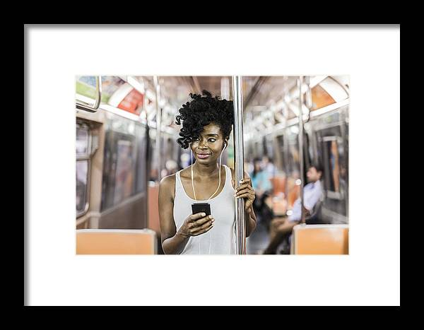 Mid Adult Women Framed Print featuring the photograph Usa, New York City, Manhattan, Portrait Of Relaxed Woman With Cell Phone In Underground Train by Westend61