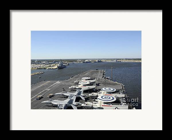 Military Framed Print featuring the photograph Uss Enterprise Arrives At Naval Station by Stocktrek Images