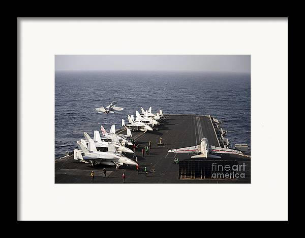Military Framed Print featuring the photograph Uss Enterprise Conducts Flight by Stocktrek Images