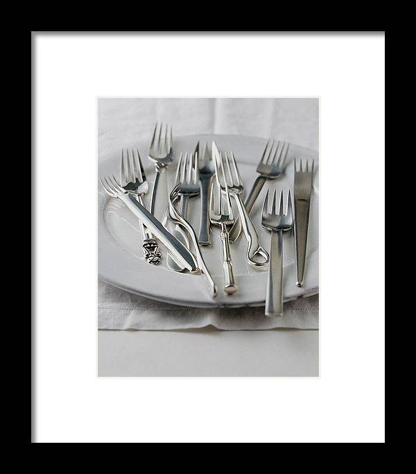 Kitchen Framed Print featuring the photograph Various Forks On A Plate by Romulo Yanes