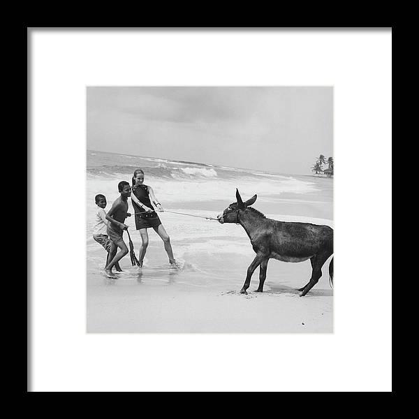 Animal Framed Print featuring the photograph Veruschka Von Lehndorff And Two Children Pulling by Franco Rubartelli