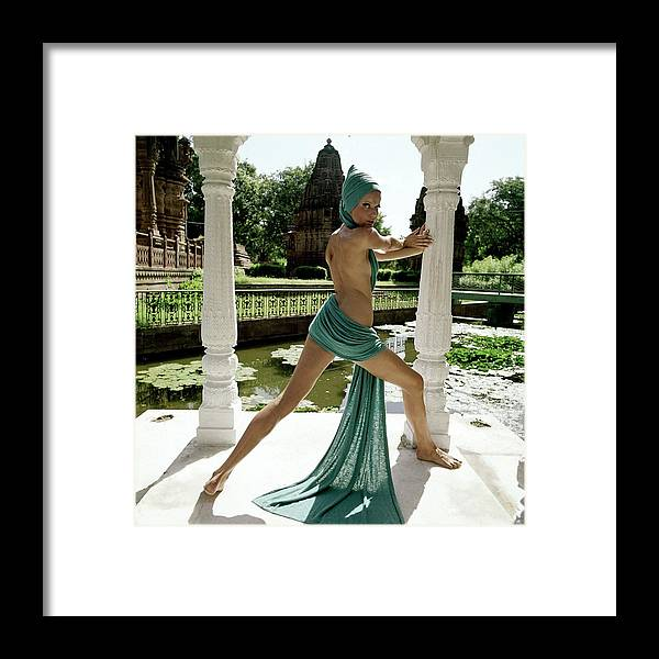 Fashion Framed Print featuring the photograph Veruschka Von Lehndorff Posing At The Gardens by Henry Clarke