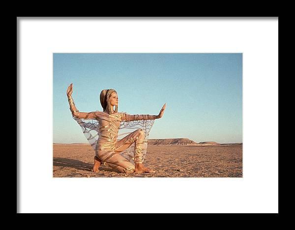 Fashion Framed Print featuring the photograph Veruschka Von Lehndorff Posing In A Desert by Franco Rubartelli