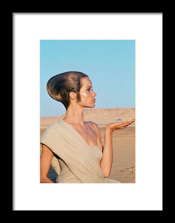 Fashion Framed Print featuring the photograph Veruschka Von Lehndorff Sitting In A Desert by Franco Rubartelli