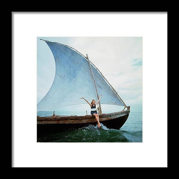 Boat Framed Print featuring the photograph Veruschka Von Lehndorff Sitting On Edge by Franco Rubartelli