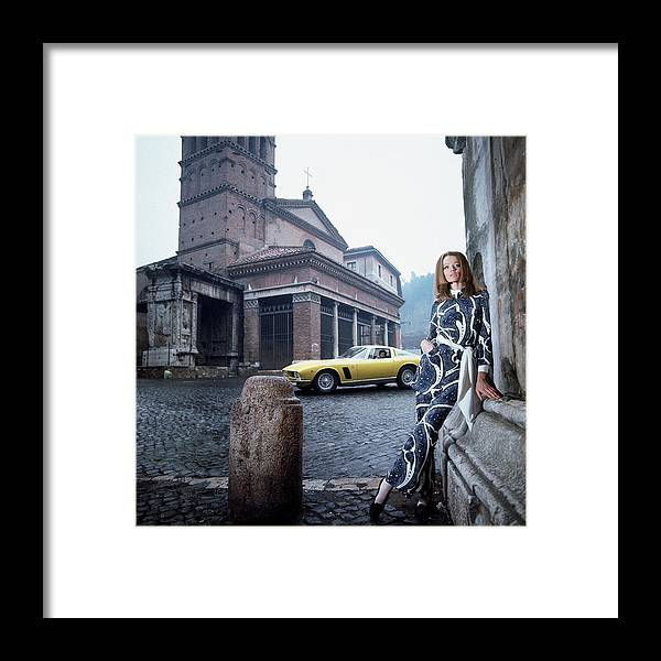 Fashion Framed Print featuring the photograph Veruschka Von Lehndorff Standing In Piazza Di San by Franco Rubartelli