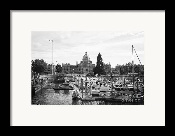 Canada Framed Print featuring the photograph Victoria Harbour With Parliament Buildings - Black And White by Carol Groenen