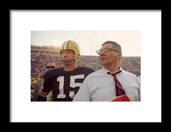 Marvin Newman Framed Print featuring the photograph Vince Lombardi With Bart Starr by Retro Images Archive