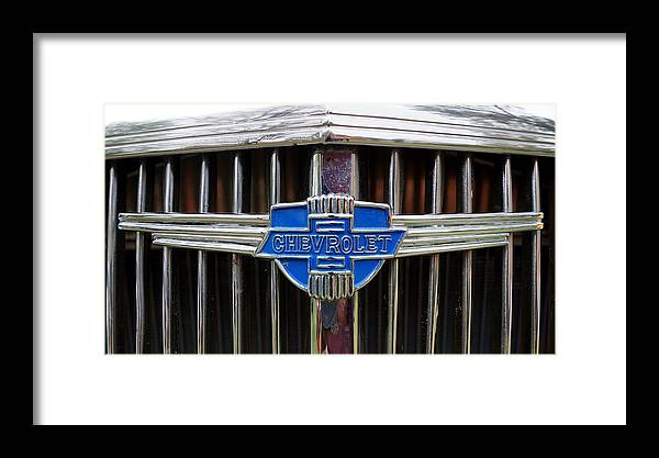 Chevrolet Framed Print featuring the photograph Vintage Chevrolet Grille Emblem by Alan Hutchins