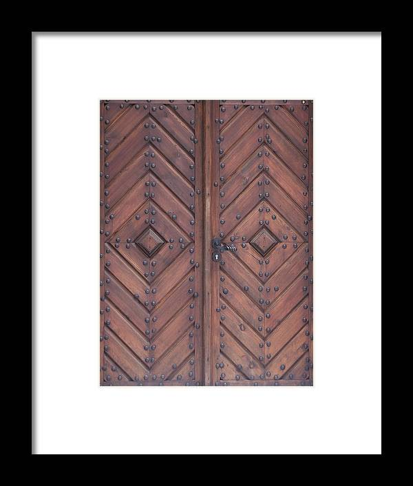 Material Framed Print featuring the photograph Vintage Wooden Brown Door Close-up by Bogdan Khmelnytskyi