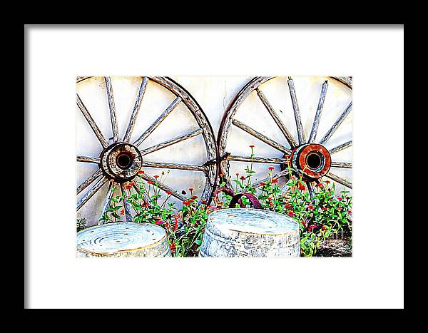 Wagon Framed Print featuring the photograph Wagon Wheel Flowers by Audreen Gieger