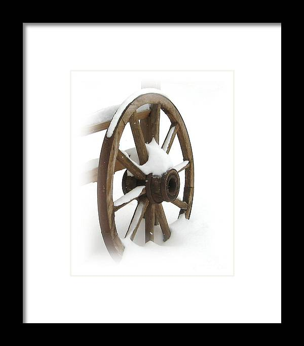 Wagon Framed Print featuring the photograph Wagon Wheel In Snow by Lynn Sprowl