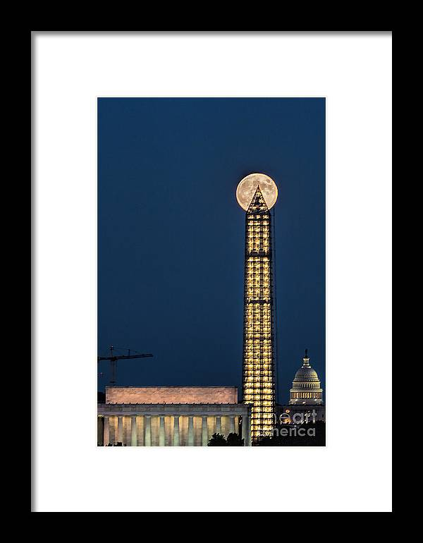 Full Moon Framed Print featuring the photograph Washington Monument Piercing The Full Moon by Izet Kapetanovic