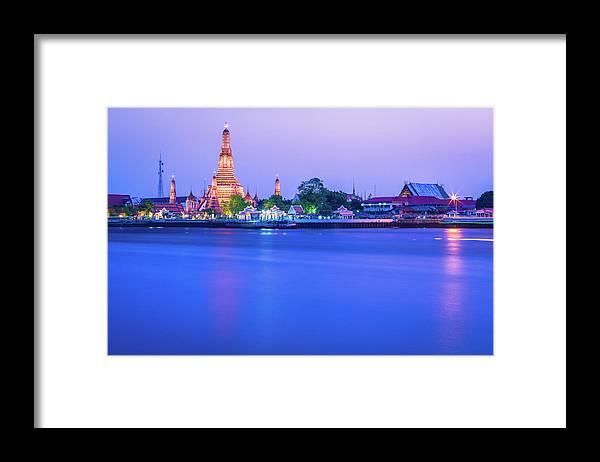Scenics Framed Print featuring the photograph Wat Arun Temple Bangkok Thailand by Deimagine