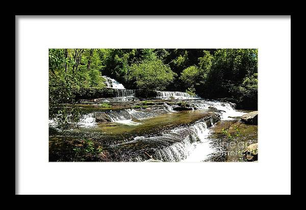 Water Framed Print featuring the photograph Water On The Rocks by Mike Hutchinson