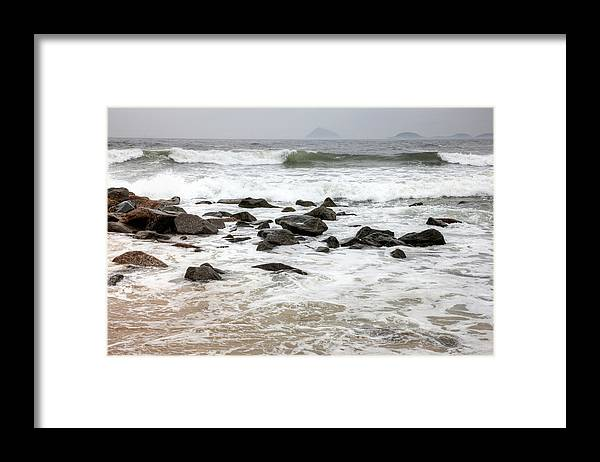 Water's Edge Framed Print featuring the photograph Waves Crashing On Copacabana Beach In by Tirc83