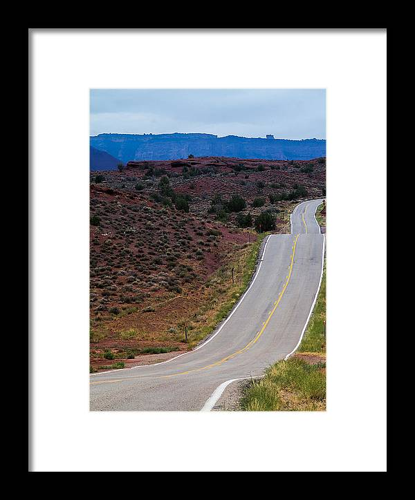 Road Framed Print featuring the photograph Wavy Road by Andreas Hohl
