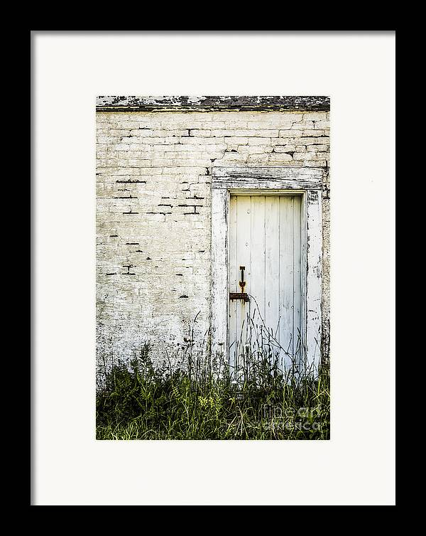 Rustic Framed Print featuring the photograph Weathered Door by Diane Diederich