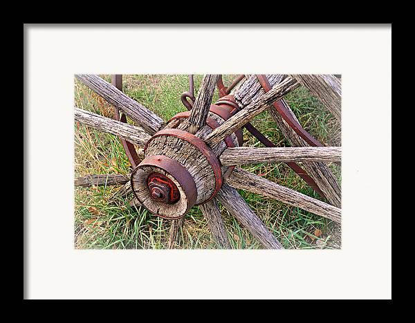 Wagon Wheel Framed Print featuring the photograph Wheel Of Old by Marty Koch