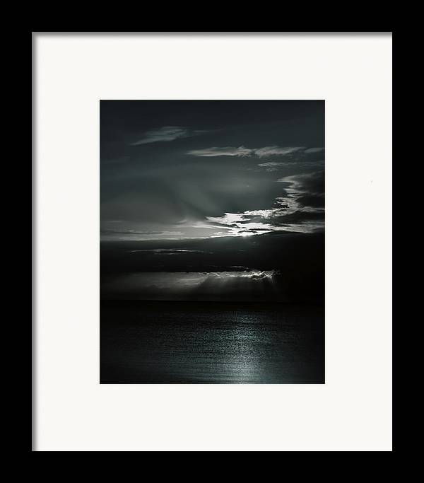 Ocean Framed Print featuring the photograph When The Sun Goes Down... by Mario Celzner