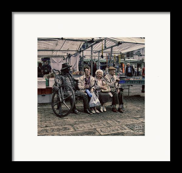 Advice For Seniors Framed Print featuring the photograph Which One Is The Statue by Doc Braham