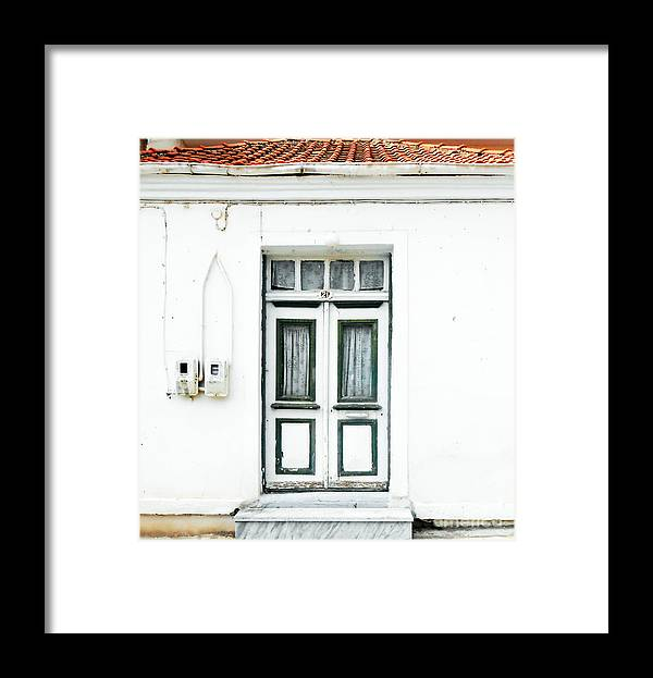 Door Framed Print featuring the photograph White And Green Door by Ioanna Papanikolaou