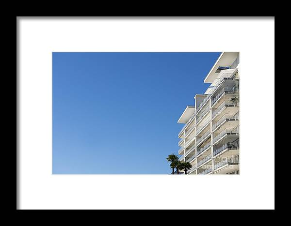 Building Framed Print featuring the photograph White Building And Palm Trees by Mats Silvan