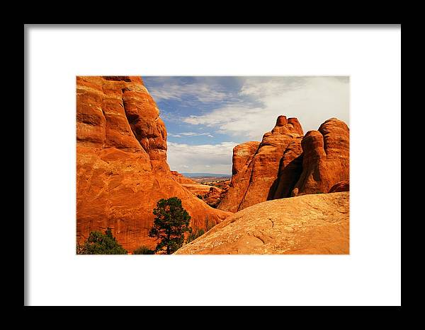 Rocks Framed Print featuring the photograph Wind Worn Beauty by Jeff Swan