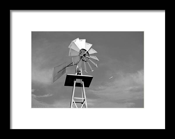 Windmill Framed Print featuring the photograph Windmill And Passing Plane by Tara Potts