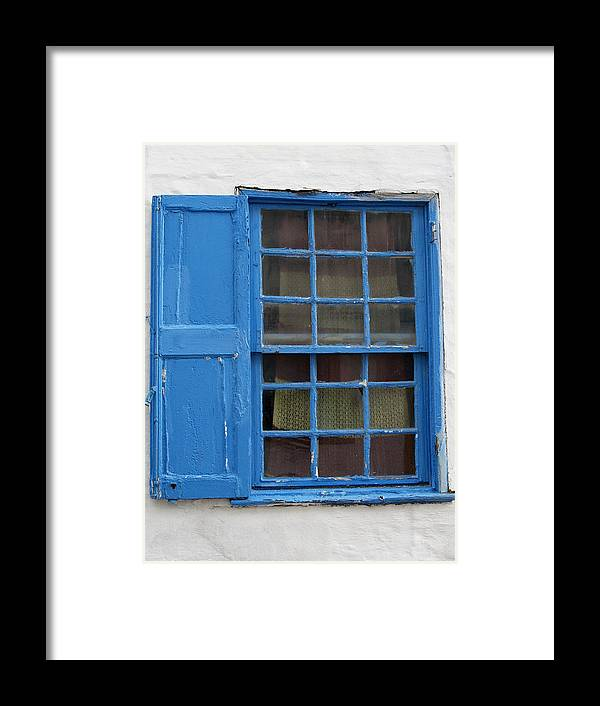 White Framed Print featuring the photograph window in blue - British style window in a mediterranean blue by Pedro Cardona Llambias