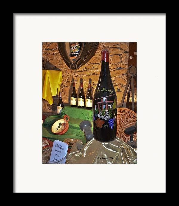 Wine Framed Print featuring the photograph Wine Bottle On Display by Allen Sheffield