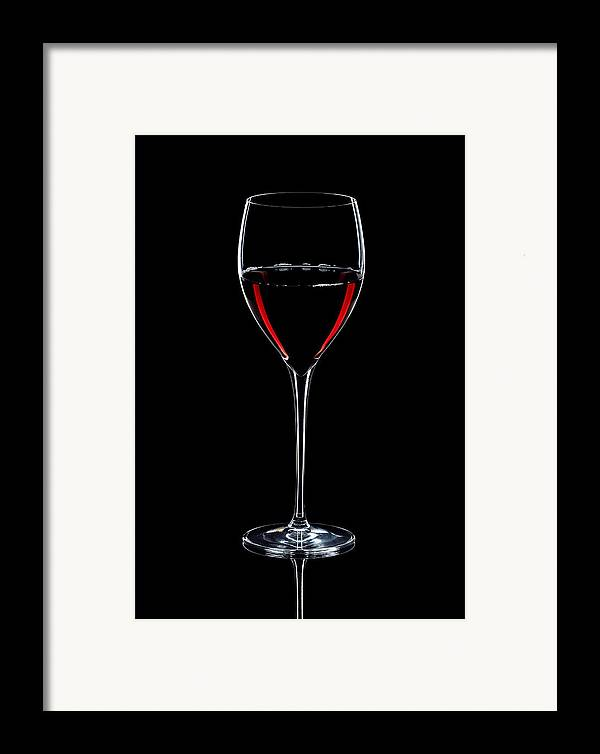 Wine Framed Print featuring the photograph Wineglass Filled With Red Wine Silhouette by Alex Sukonkin
