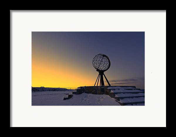 Longitude; Latitude; Arctic; Cape; Concept; Europe; European; Evening; Famous; Globe; Monument; Nature; Nordkapp; North; Northern; Northland; Norway; Norwegian; Point; Postcard; Scandinavia; Sign; Silhouette; Sky; Sphere; Statue; Sun; Sunset; Symbol; Symbolic; Tourism; Travel; View; World; Northernmost Point; Dawn; Dusk; Golden Framed Print featuring the photograph Winter Beyond The Arctic Circle by U Schade