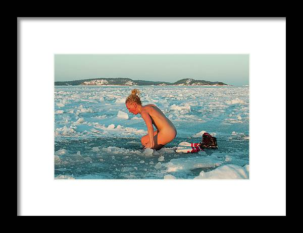 Three Quarter Length Framed Print featuring the photograph Woman Bathing Naked In Ice Hole by Helena Wahlman