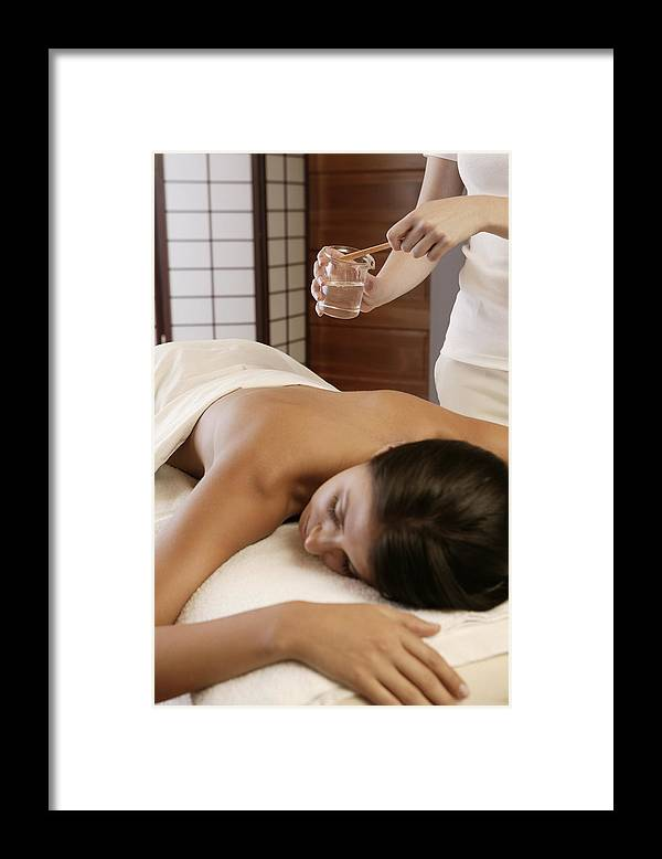 Relief Framed Print featuring the photograph Woman getting hot oil massage by Comstock Images