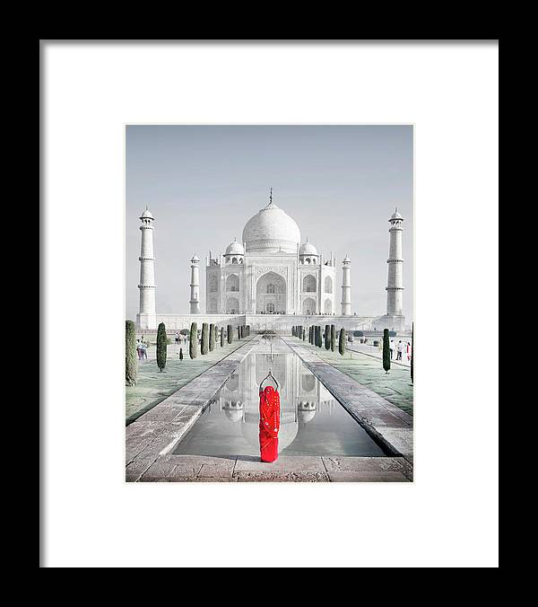 Tranquility Framed Print featuring the photograph Woman In Red Sari Praying At Taj Mahal by Grant Faint