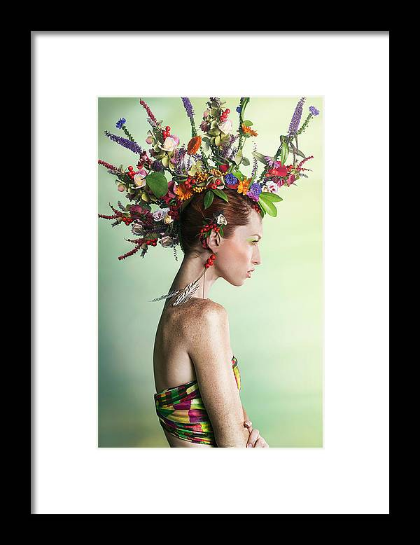 Art Framed Print featuring the photograph Woman Wearing A Colorful Floral Mohawk by Paper Boat Creative