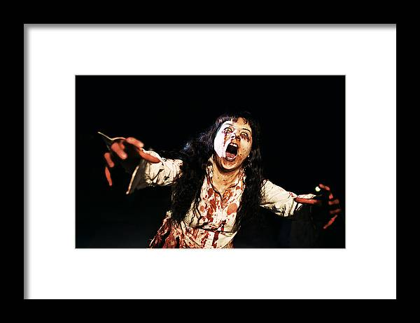 Problems Framed Print featuring the photograph Woman zombie walks at night by Laura Natividad