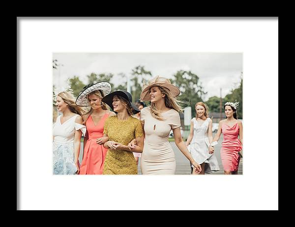 Event Framed Print featuring the photograph Women Walking to Racecourse by SolStock