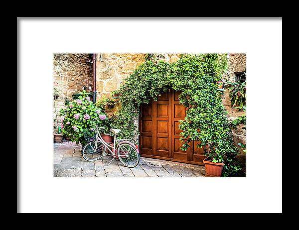 Val D'orcia Framed Print featuring the photograph Wooden Gate With Plants In An Ancient by Giorgiomagini