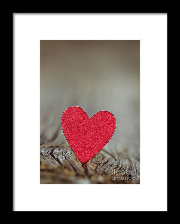 Heart Framed Print featuring the photograph Wooden Red Heart On Rustic Background by Anna-Mari West