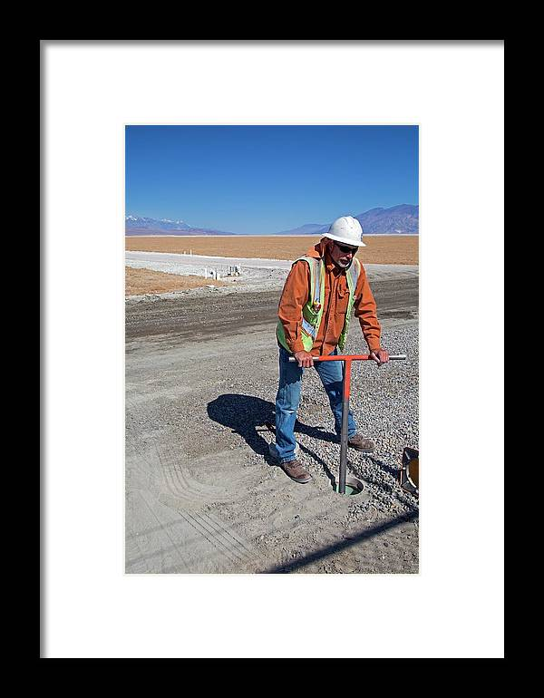 Human Framed Print featuring the photograph Worker Digging A Bore Hole by Jim West